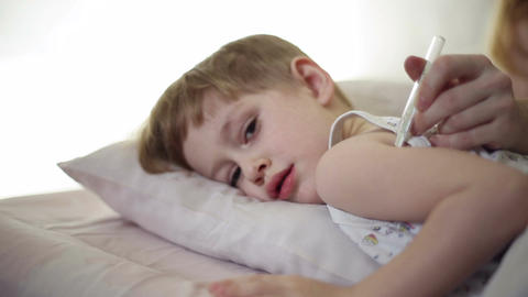 The boy is sick and he has fever Live Action