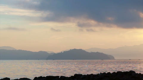 Tropical sunrise on beach paradise. Colourful cloud with ocean reflecting Footage
