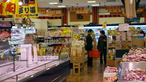 Video of OSAKA, JAPAN - March 2015: People walking and shopping in Supermarket in Japanese local Archivo