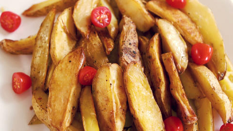 View of a plate of potato wedges Footage