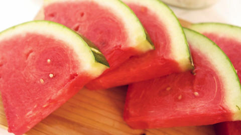 View of slices of watermelon on a wooden board Footage