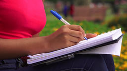 Female Teen Writing In Journal Or Notebook Live Action