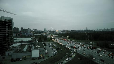 Aerial rising shot of big city highway intersection in the evening rush hour フォト