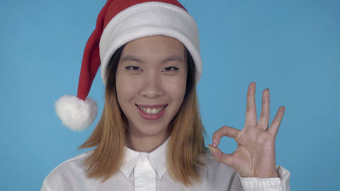 beautiful korean girl christmas showing gesture ok Footage
