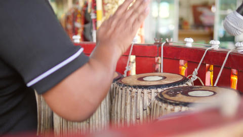 Asian Artist is Drumming by Hands on Traditional Drums Instrument in Temple. 4K Footage