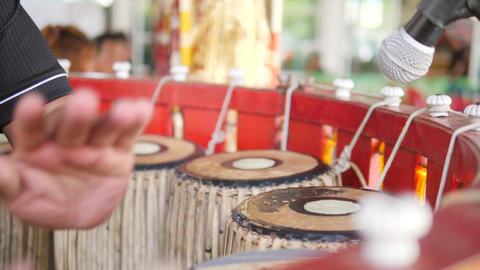 Asian Artist is Drumming by Hands on Traditional Drums Instrument at Ceremony in Footage