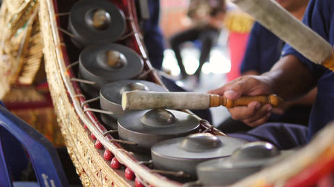 Thai Drummer Playing Music with Drumsticks on Traditional Metal Gong Drums Live Action