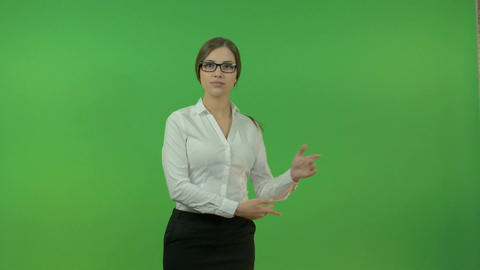 Business lady gesturing with hands on a green background. Presentation 影片素材