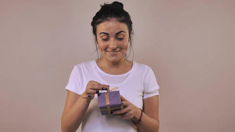 cheerful female with gift Footage