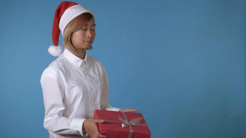 beautiful girl like santa holding red box with present Footage