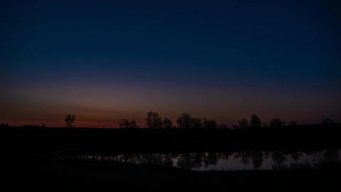 Beautiful clouds over a lake at sunrise, with brilliant... Stock Video Footage
