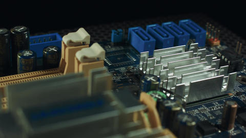 components of the motherboard are spinning on a black background, sata slots and Footage