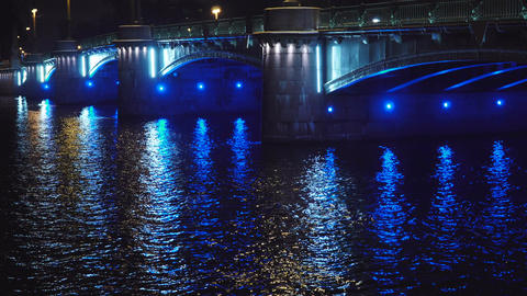 Beautiful Historic bridge across the river in a European city at night tilt up Footage