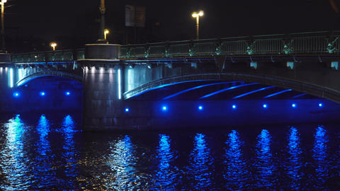 Beautiful Historic bridge across the river in a European city at night panorama Footage