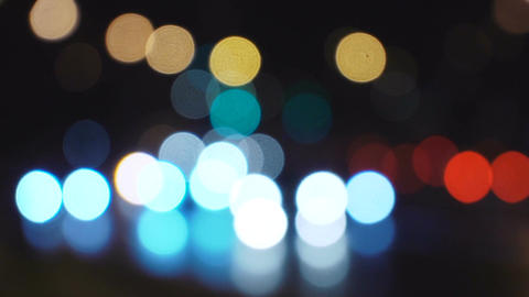 Defocused night city bokeh traffic lights handheld footage with slight movement Footage