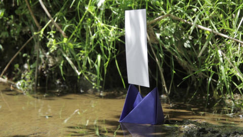 Blue paper boat with mast on the river 26 Footage