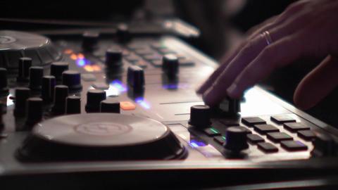 Dj mixes at the mixer at a music contest - 77 Live Action