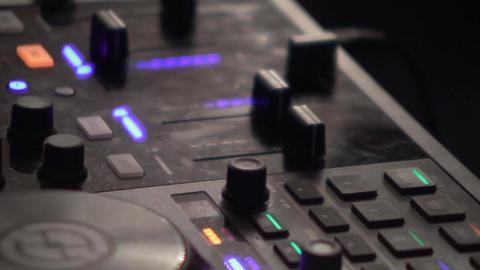 Dj mixes at the mixer at a music contest 74 Live Action