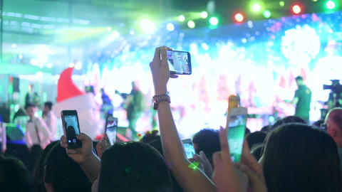People Having Fun at New Year Christmas Party Concert and Taking Video with Footage