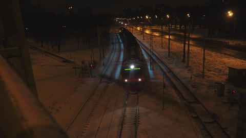 Night train goes under the bridge at winter Footage
