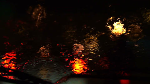 Video of beautiful colorful blurry light of traffic outside on the road. Rain fl Footage