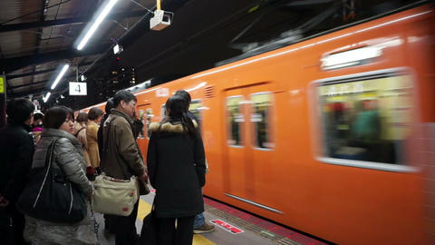 OSAKA, JAPAN - March 2015 : People waiting train at subway station. Train is arr Footage