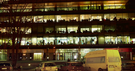 Office building viewed in the evening, with traffic, 4k, time lapse Footage