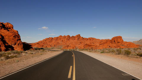 Long and empty road through the Valley of Fire National Park Footage