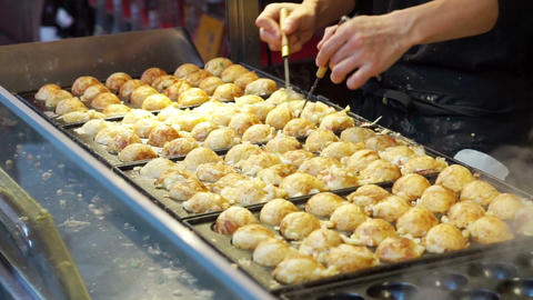 Cooking takoyaki Japanese octopus flour ball. Traditional Japan snack cuisine Footage