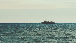 Big fishing ship floating on the waves of the sea Footage