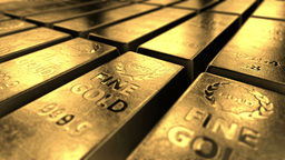 Close-up view of shiny gold bars stacked up in perfect rows with ambient light r Footage