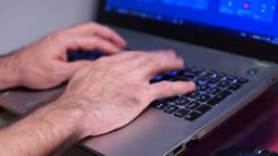Man typing on laptop keyboard Footage