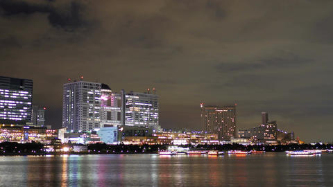Reflection of city lights off the shore of Daiba 画像