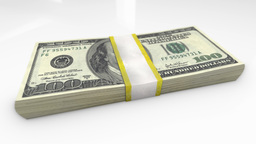 A close-up view of the bundle of one hundred dollar bills lying on white glass s Footage