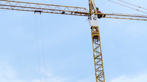 Two crane working together at building construction site with sky background Footage