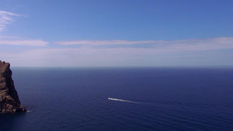 The blue Mediterranean sea blue ocean water and cliffs Live Action