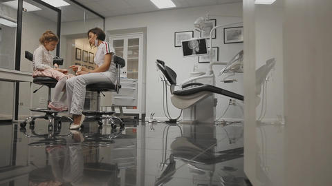 In the dentist's office orthodontist on the background of the x-ray head of a Live Action