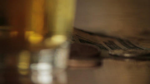 Money flopped onto bar next to beer macro Footage