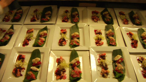 Long line of sushi plates Live Action