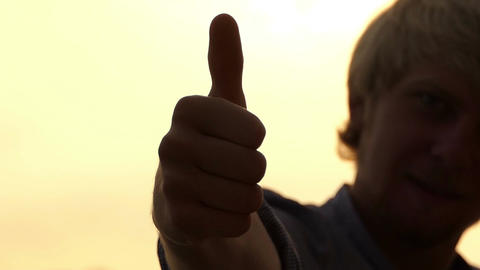 Happy Man Throws His Hand Forward And Shows a Thumb up Gesture in Slo-Mo Footage