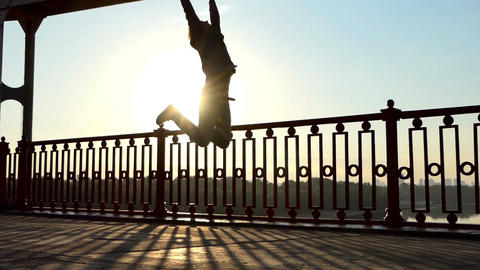 Young Man Dances, Jumps, Goes on His Hands, Being Happy, Ona Bridge in Slo-Mo Footage
