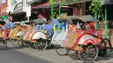 JOGJAKARTA - MAY 2012: transportation with cyclo Footage