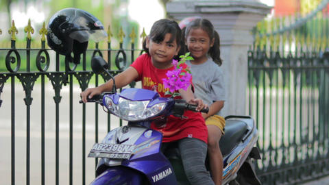 JOGJAKARTA - MAY 2012: two local kid on motorbike Stock Video Footage