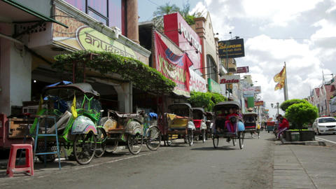 JOGJAKARTA - MAY 2012: transportation with cyclo Stock Video Footage
