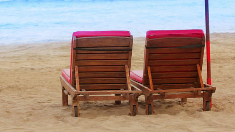 two sunbed on beach Stock Video Footage
