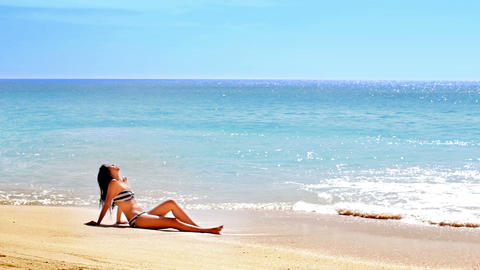 Sunbathing and Tanning at Exotic Beach Stock Video Footage