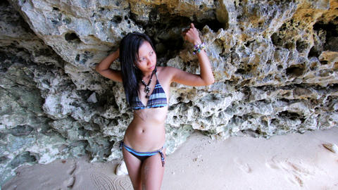 Sexy Asian Girl Lean Against Rock Stock Video Footage