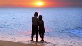 romantic couple at beach during sunset Footage