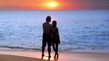 romantic couple at beach during sunset Stock Video Footage