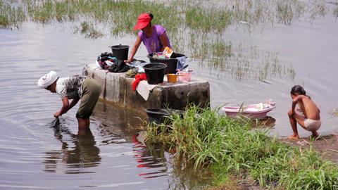 BALI - MAY 2012: people washing clothes, batur danau lake Stock Video Footage